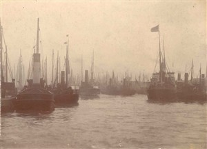 Photo:Steam drifters in port with steam tug