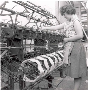 Photo:Reeling silk from skeins onto bobbins