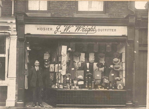 Photo:Mr John W. Wright standing outside his men's outfitters shop, 57 High Street, Gorleston, 1922-1925