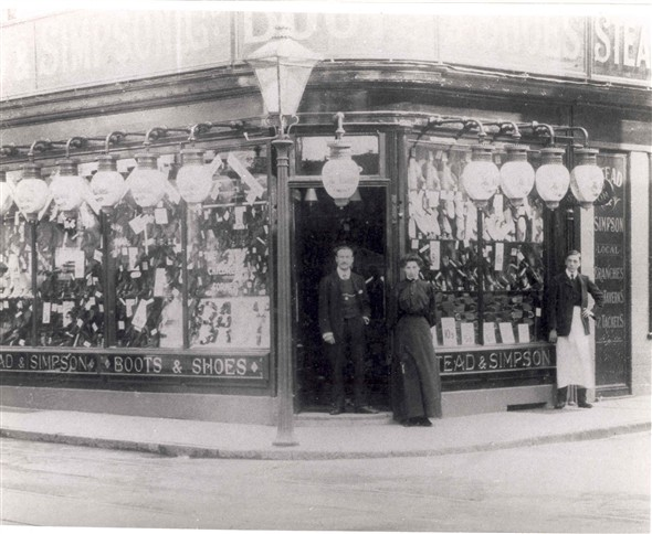 Photo:Staff standing outside Stead & Simpson, Great Yarmouth, early 19th Century