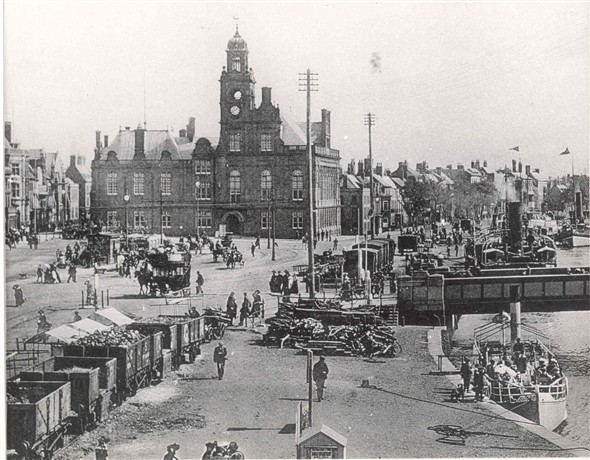 Photo:Busy quayside scene around the old Haven Bridge