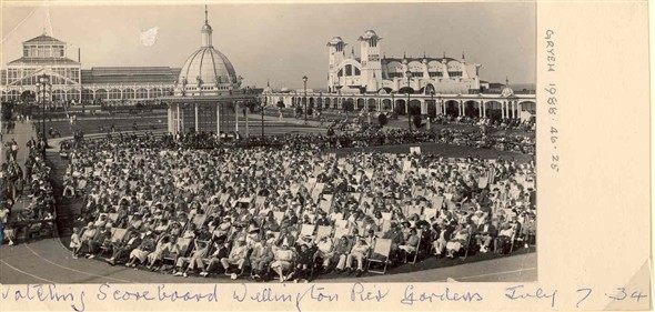 Photo:Watching the Scoreboard, Wellington Pier Gardens 1934