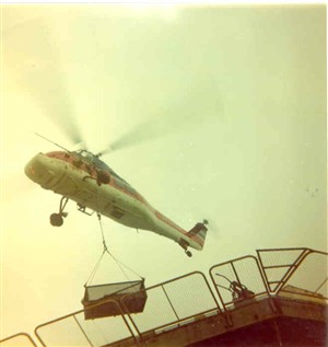 Photo:Helcopter working at a platform