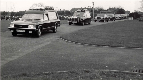 Photo:Hearses carrying out a funeral, 1981