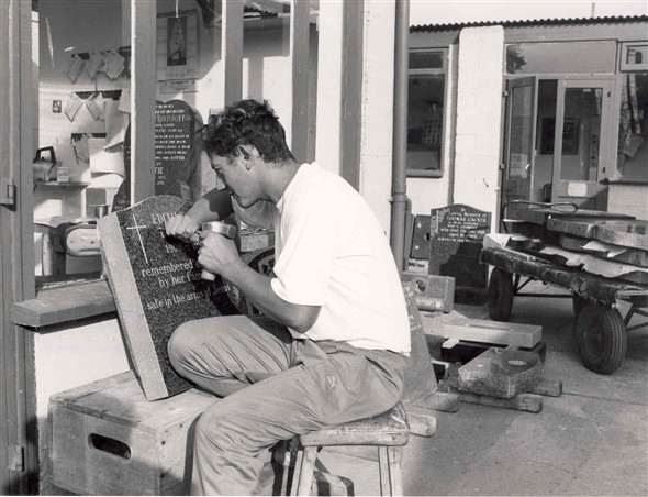 Photo:Glen Thain using traditional tools to hand carve a headstone, 1991