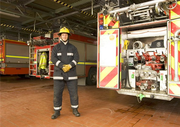 Photo:Portrait of fireman Aaron Tills in the fire station