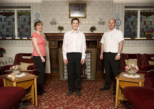 Photo:Portrait of Greg and Samantha Haddon with their son Tom in the entrance hall of their guesthouse