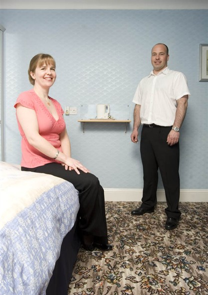 Photo:Portrait of Greg and Samantha Haddon in one of the guesthouse bedrooms