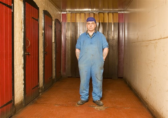 Photo:Mike Kelly standing in the corridor which opens on the smoking sheds