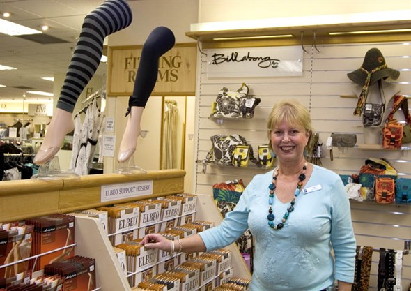Photo:A member of staff in the hosiery department at Palmers