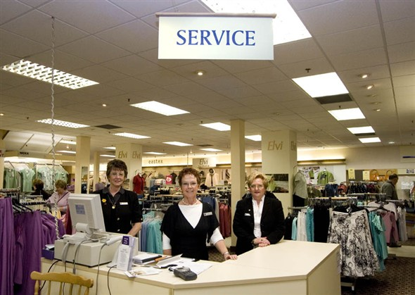 Photo:Group portrait of M. Powlls, M. Jennings & D.Richards behind the service counter in the womens wear department at Palmers