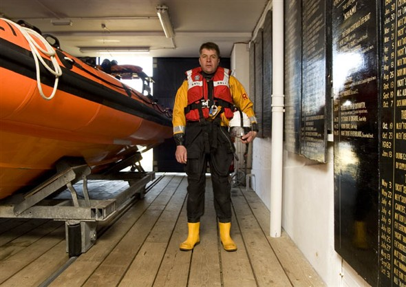 Photo:Portrait of S. Bartram, Coxswain of the Gorleston lifeboat crew, in the lifeboat shed