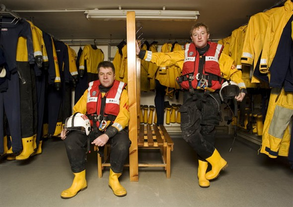 Photo:Portrait of S. Bartram (Coxswain) and P. Lee (station mechanic) in the kit room