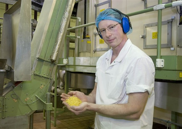 Photo:Portrait of Michael Randell holding some of the pasta