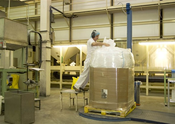 Photo:Portrait of Ray Amis packing pallets of pasta for transporting