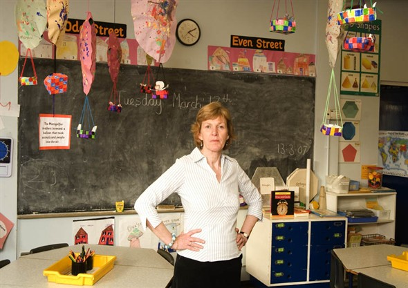 Photo:Potrait of Mrs Cruickshank infront of the blackboard in her classroom