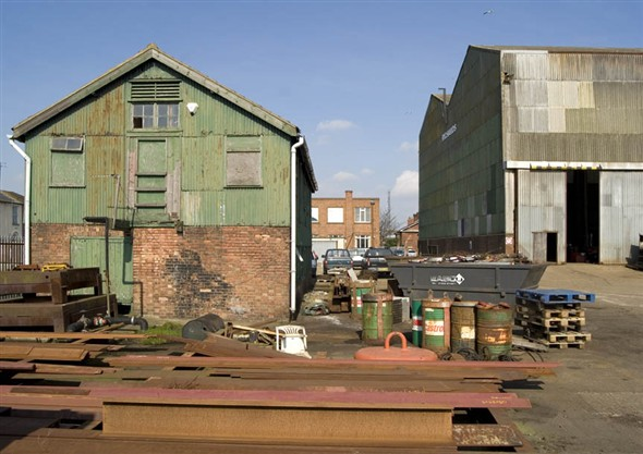 Photo:View of the ship yard with the boat building shed and the offices in the background