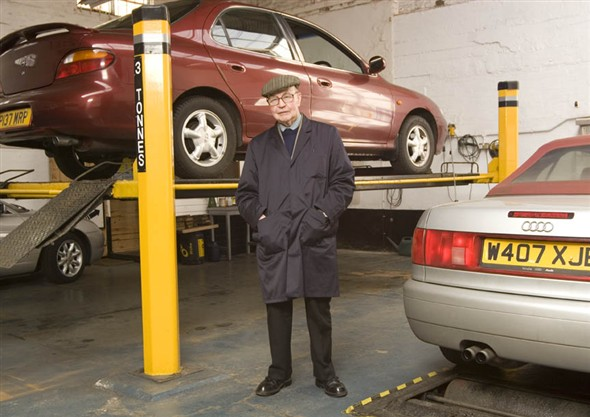 Photo:Portrait of Mr. P. Trett, owner and manager of Tretts garage in the MOT Testing area