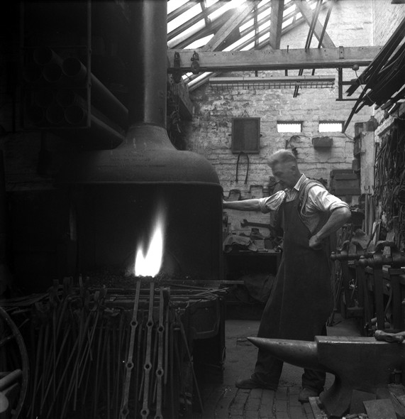 Photo:Photograph of Fred Leak working in his Smithy in 1963