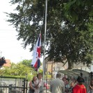 Photo:Miss Hopley lowering the school flag to mark the closure.
