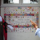 Photo:The Mayor unveiling the tile wall created by the children and staff at Alderman Swindell Primary School.