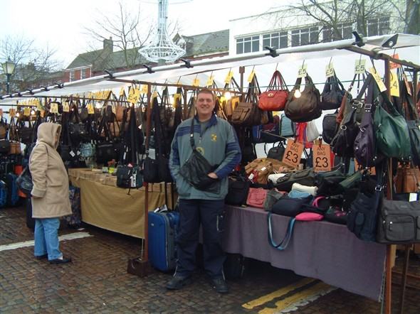 Photo:Alan Pitt, Market Trader, at his stall