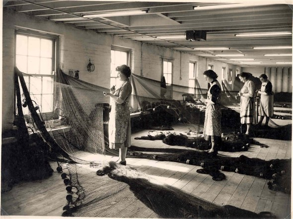 Photo:Beatsters at work, mending nets, 1950's