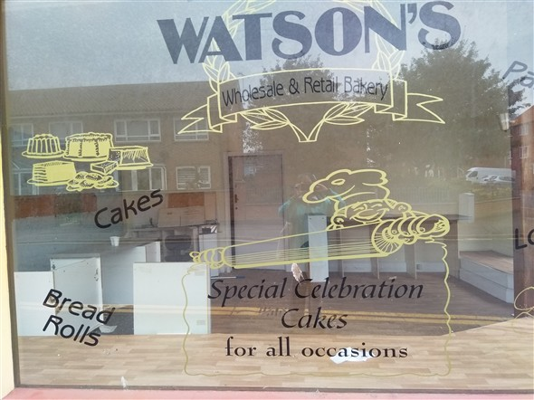 Photo:Close up of etched window of Watson's Bakery