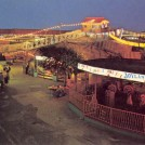 Photo:Modern colour postcard showing Britannia Pier and Joyland by night