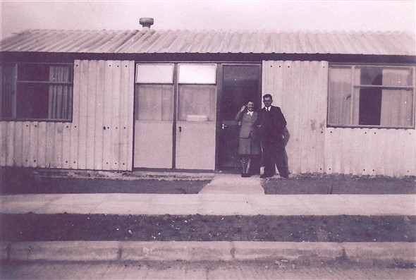 Photo:Photograph of a couple outside a prefab on Shrublands Estate