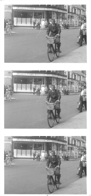 Photo:George arrives at 53 Regent Road on his bicycle with his Leica camera around his neck.