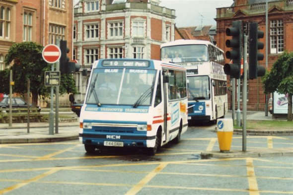 Photo:No ? (E44 OAH) Minibus on Hall Quay with town hall in background